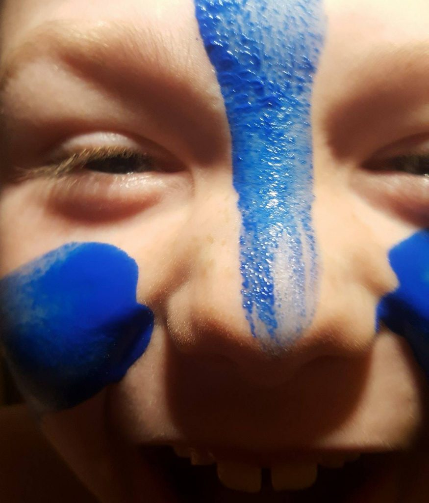 woad paint on face of child