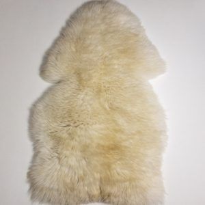 A fluffy Shetland sheepskin for the UK on white background