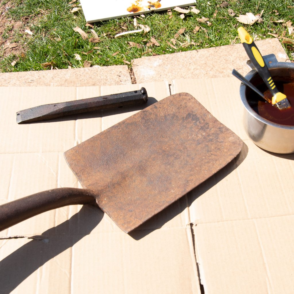 a spade head and wedge ready for rust conversion
