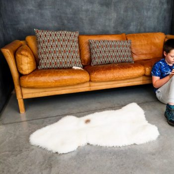 Brown sheepskin on brown leather sofa