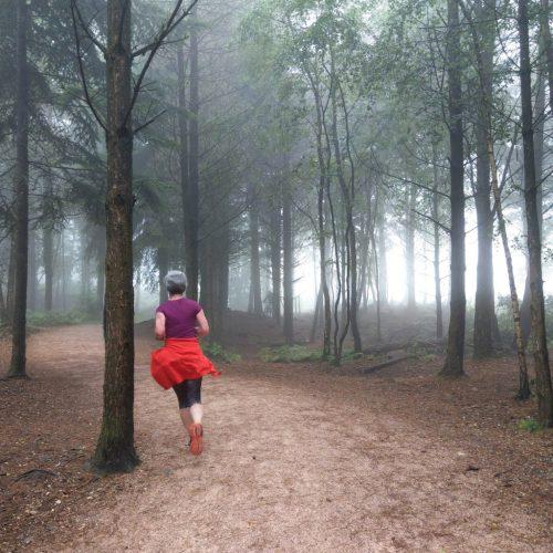 woman runs in Haldon Great Forest